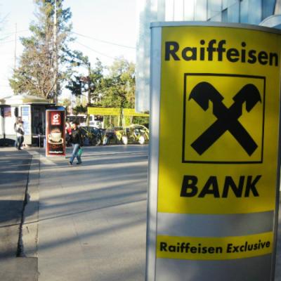 Raiffeisen Bank ajunge cu legea darii in plata la Curtea Constitutionala
