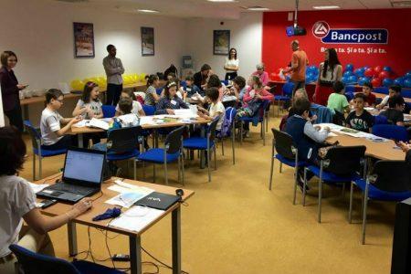 """Peste 500 de elevi au luat parte la sesiunile de educatie financiara organizate de Bancpost in cadrul Saptamanii """"Scoala Altfel"""""""