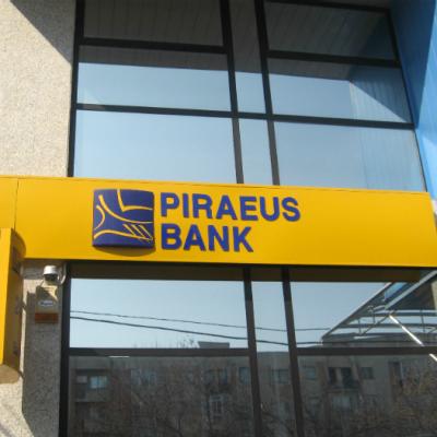 Piraeus Bank propune clientilor sai conversia creditelor in franci elvetieni, cu discount total de 35%